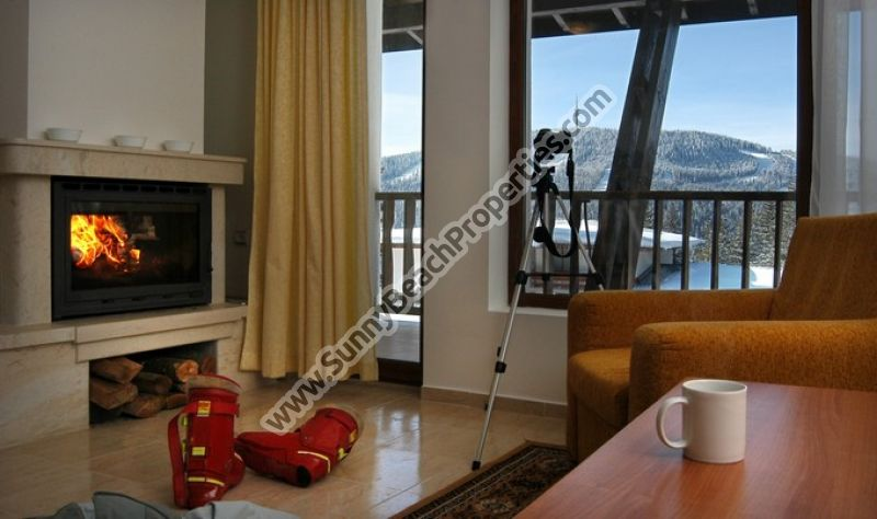 1-bedroom apartments with fireplace  in Monastery 2 1000m. from the ski runs in Pamporovo ski resort.