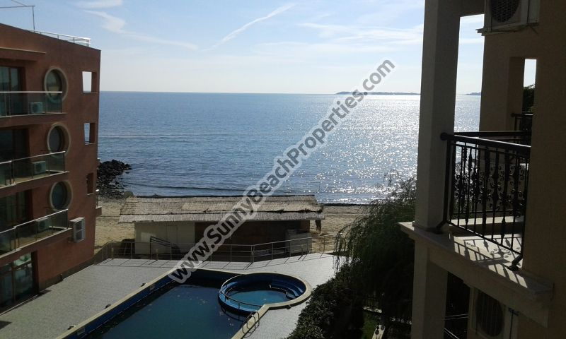 Beachfront sea and mountain view luxury furnished 1-bedroom apartment for sale in Dolphin Coast VIP Club only 20 m. from the beach in Sunny Beach.
