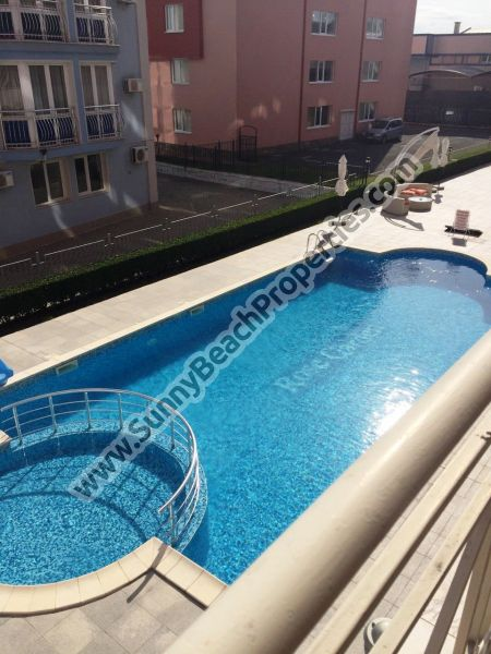 Pool view furnished 1-bedroom apartment for sale in Rose Garden in tranquil area in the central part of Sunny beach and 400 m. from the beach.