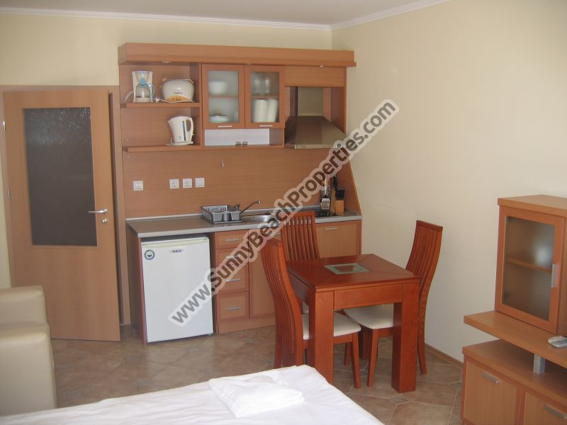 Park view furnished studio apartment for sale in Central Plaza in absolute tranquility in the centre of Sunny beach