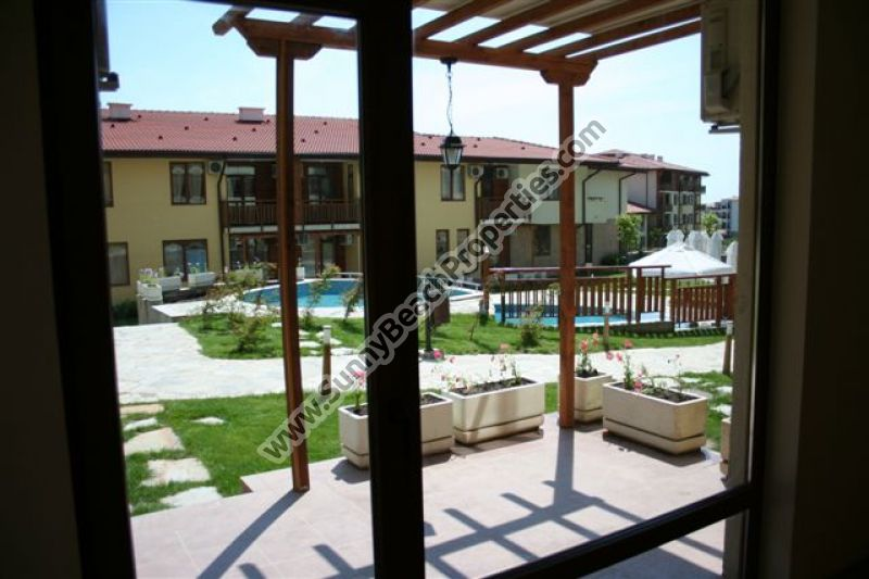 Pool view 1-BR apartment for sale in 5***** Garden of Eden right on the beach in St Vlas