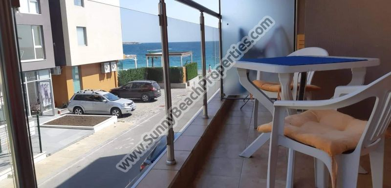 Beachfront Sea view furnished studio apartment for sale in residential building without maintenance in absolute tranquility 20m. from the beach in Ravda