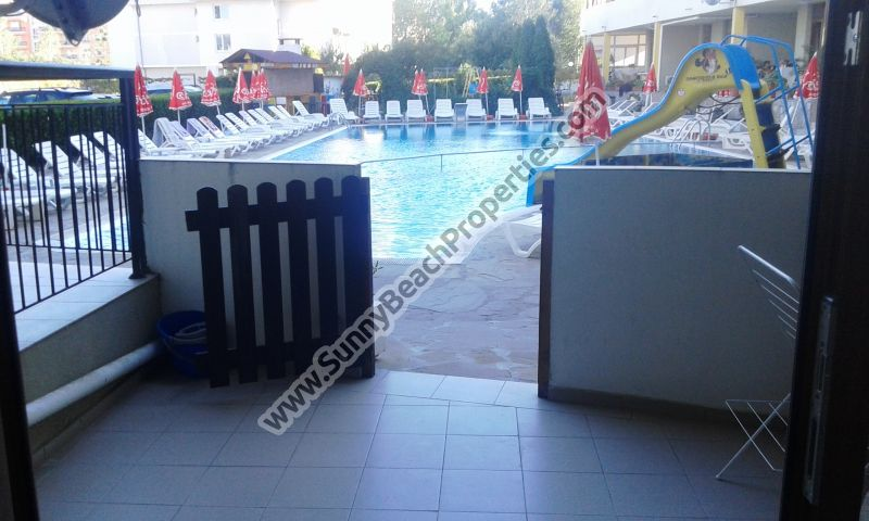 Pool view furnished studio apartment with enclosed porch for sale 300 m. from the beach and 50 m. from supermarket Mladost in Sunny beach