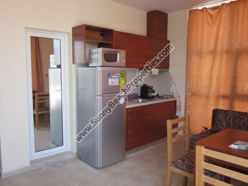 Half furnished 1-bedroom apartment for sale in residential building Crystal Park tranquil area downtown Sunny beach 200 m. from the beach