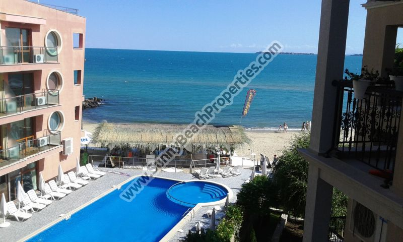 Beachfront sea view & mountain view luxury furnished 1-bedroom apartment for sale in Dolphin Coast VIP Club only 20 m. from the beach in Sunny Beach.
