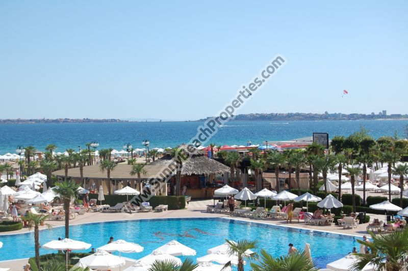 Beachfront sea and pool view furnished 1-bedroom apartment for sale in 4**** Majestic aparthotel right on the white sandy beach in Sunny beach.