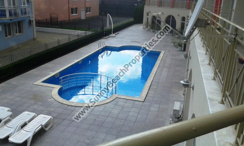 Pool view furnished 1-bedroom apartment open plan for sale in Rose Garden in tranquil area in the central part of Sunny beach and 800 m. from the beach.