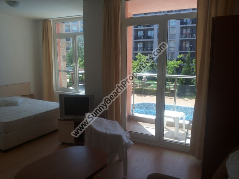 Pool view spacious furnished studio apartment for sale in 5 in 1 Rainbow resort 250m. from the beach in Sunny beach.
