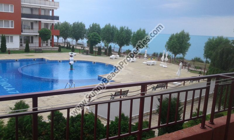 Stunning beachfront sea, pool & mountain view furnished 1-bedroom apartment for sale in Fort Noks Grand Resort, Panorama Fort Beach, Sveti Vlas, Bulgaria