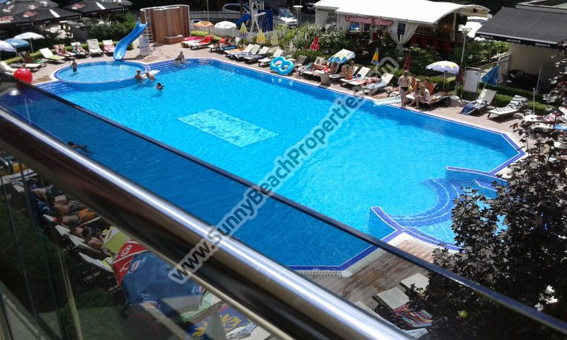 Pool view luxury furnished studio apartment for sale in Admiral Plaza downtown Sunny beach and 100m. from the beach.